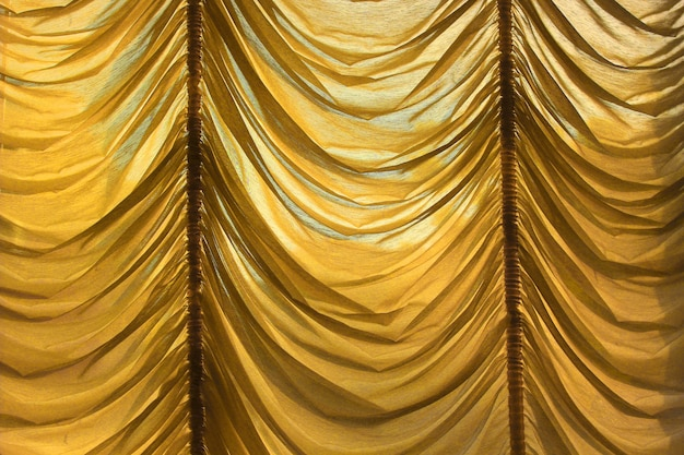 Beautiful golden curtains are used to decorate the interior.