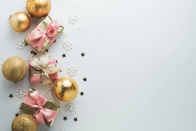Beautiful golden gifts gloden baubles on white. christmas, party, birthday background. celebrate shinny surprise boxes copyspace. creative flat lay top view.
