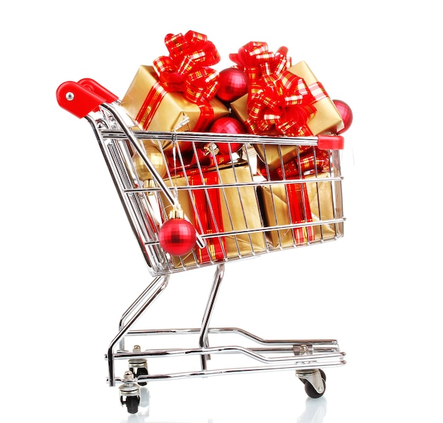 Beautiful golden gifts with red ribbon and christmas balls in  shopping cart isolated on white