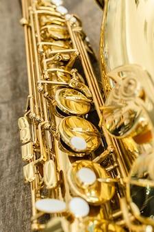 Beautiful golden saxophone on wood