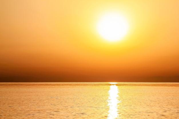 Beautiful golden sunrise as seen from the beach at rhodes, greece
