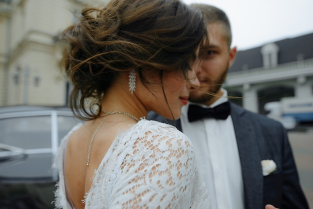 Beautiful gorgeous bride and stylish handsome groom