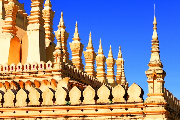 Beautiful great golden pagoda in buddhist temple with blue sky