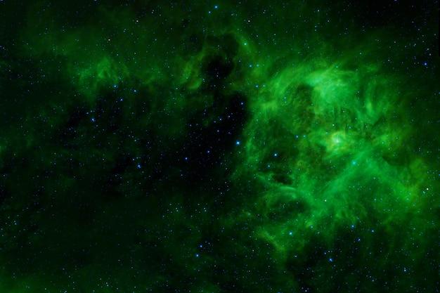 Красивая зеленая галактика. элементы этого изображения были предоставлены наса. фото высокого качества