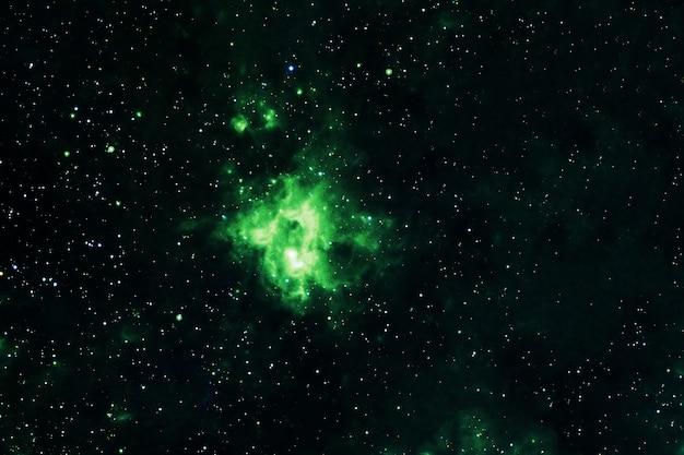 Красивая зеленая галактика со звездами. элементы этого изображения были предоставлены наса. фото высокого качества