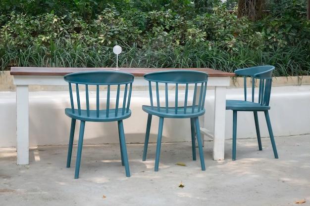 Beautiful green summer garden with outdoor chair