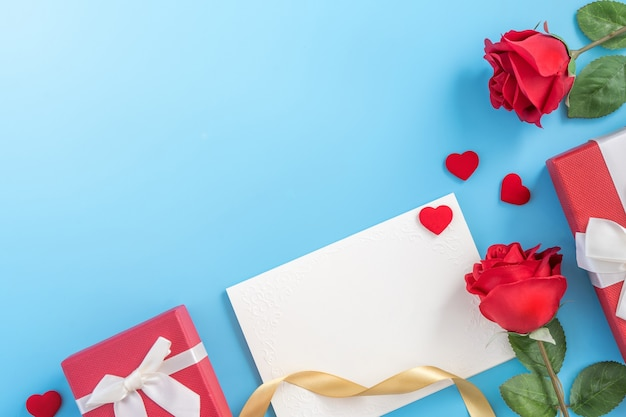 Beautiful greeting invitation card, concept of mother day, valentine day, anniversary and birthday isolated on blue color background, copy space, top view, flat lay