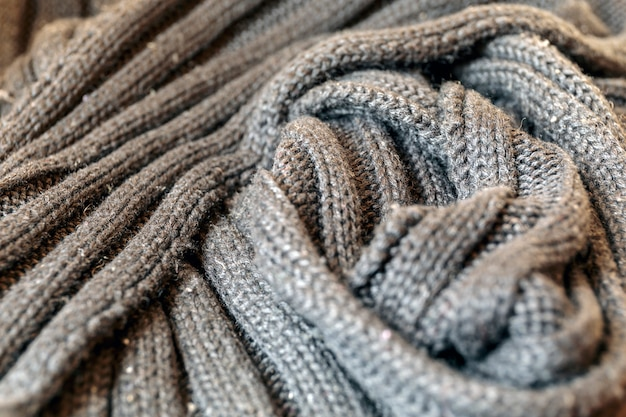 Beautiful grey background hand knitted textile