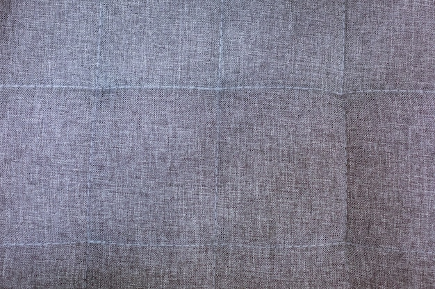 Beautiful grey textured background made of close-up material, furniture fabric