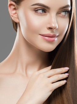 Beautiful hair healthy smooth long brunette woman hairstyle beauty. studio shot. on gray.