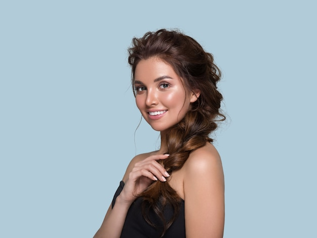 Beautiful hair woman curly hairstyle female. color background. blue