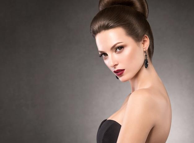 Beautiful hairstyle woman beauty hair fashion makeup red lipstick. studio shot.