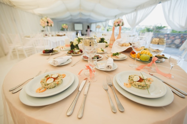 Beautiful hall under a tent for a wedding reception