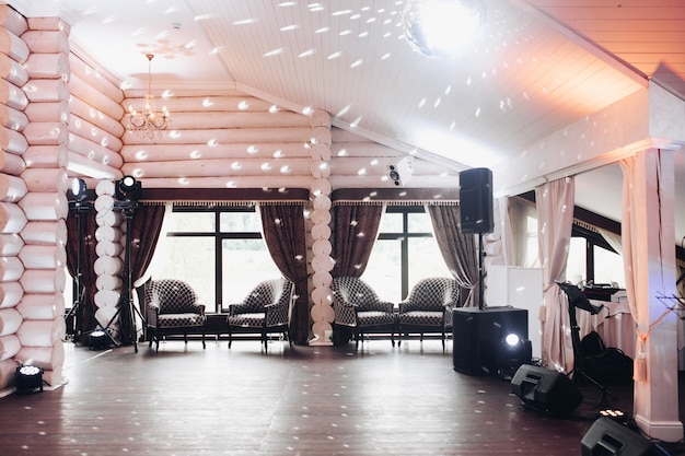 Beautiful hall with disco ball on the ceiling