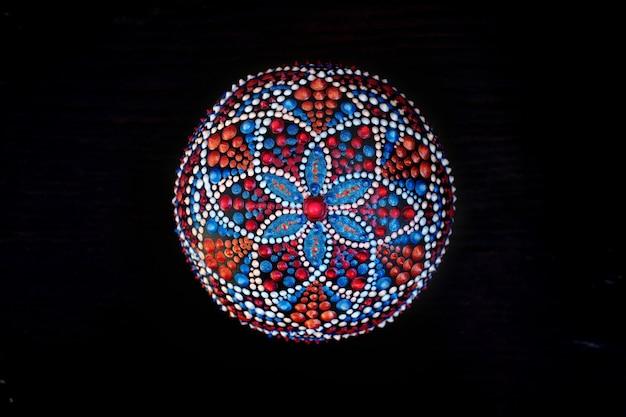 Beautiful hand painted mandala on black background