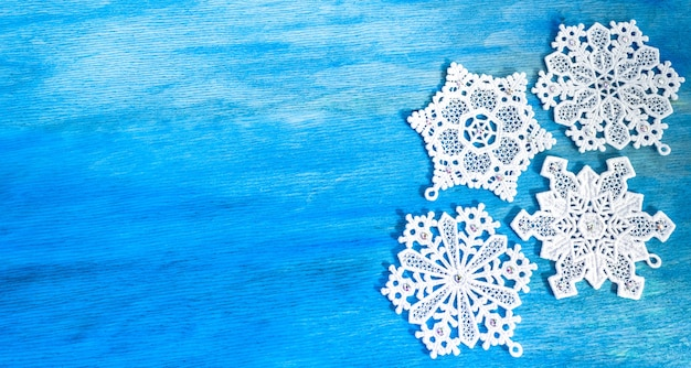 Beautiful handmade snowflakes on a wooden background. copy space