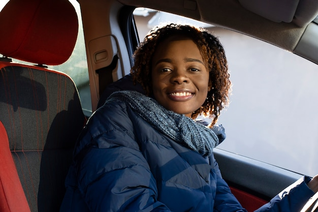 The beautiful and happy african american in the car