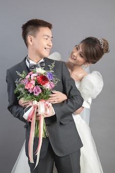 Beautiful happy couple in wedding in studio