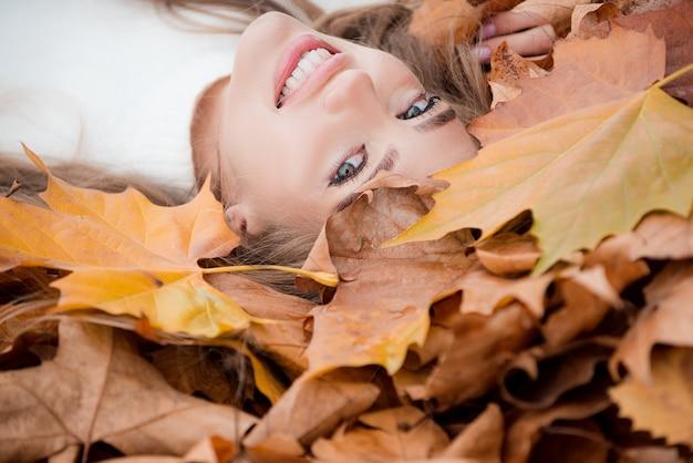 Beautiful happy elegant woman in autumn park.
