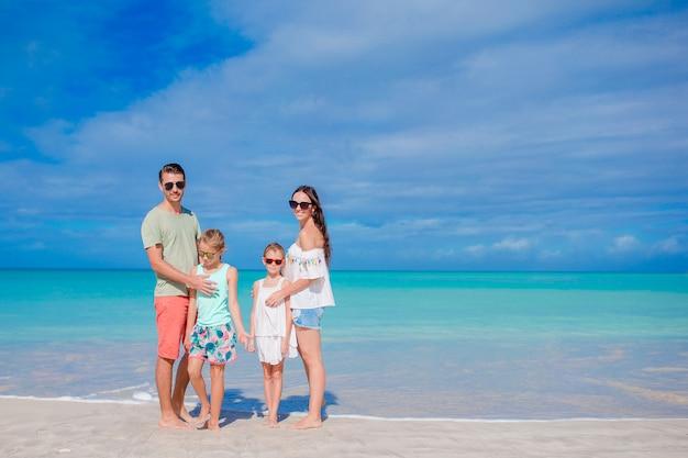 Beautiful happy family on the beach
