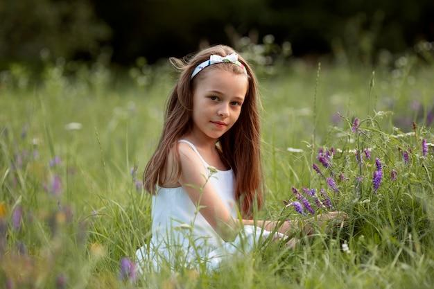 Beautiful happy girl having fun in nature