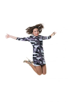 Beautiful happy girl jumping in the studio on white. the joy of shopping.