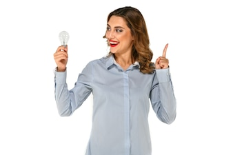 Beautiful, happy girl looking to the side on bulb with raised forefinger