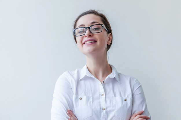 Beautiful happy girl smiling. portrait of young woman in eyeglasses isolated on white background. positive human emotion facial expression body language.