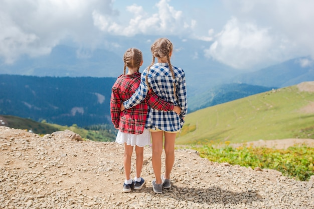 Beautiful happy little girls in mountains