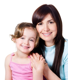 Beautiful happy mother with little pretty smiling daughter