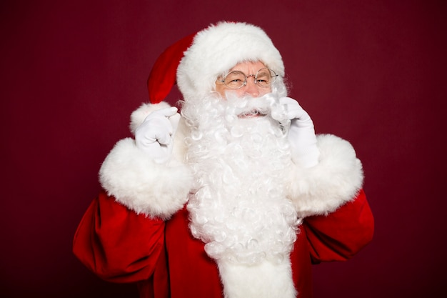 Beautiful happy santa claus is talking on a smartphone