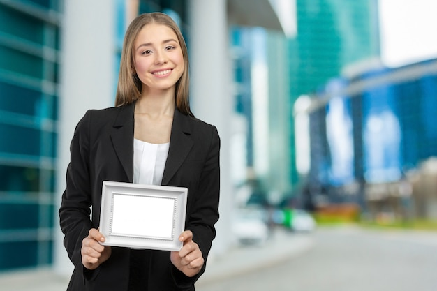 Beautiful happy smiling woman showing copy space