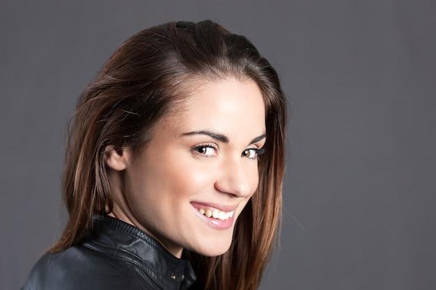 Beautiful happy woman in studio