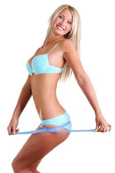 날씬한 그림 및 측정 테이프와 함께 아름 다운 행복 한 여자. 공백을 통해 프로필보기.
