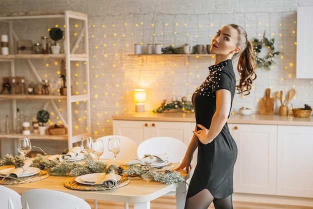 Beautiful happy young girl of the new year kitchen
