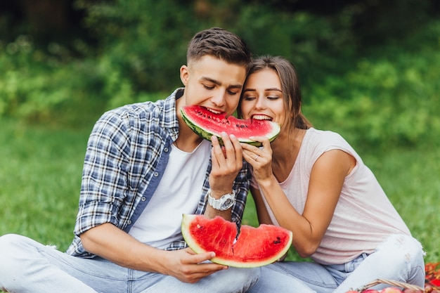 Beautiful healthy young couple with healthy food. watermelon and summer.