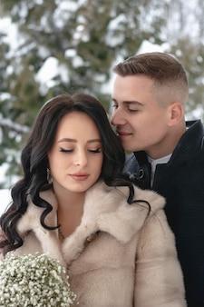 Beautiful heterosexual couple hugging outside in winter. close-up portrait