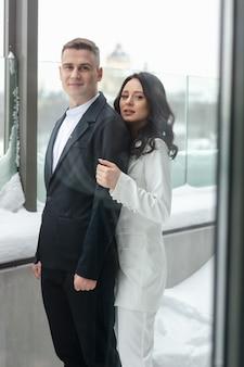 Beautiful heterosexual couple hugging outside in winter.
