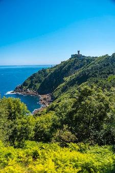 The beautiful hidden cove of monte igueldo, guipuzcoa, basque country. excursion from san sebastián to the town of orio through mount igeldo walking 3 friends.