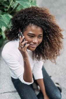 Beautiful hispanic woman talking on phone indoors.