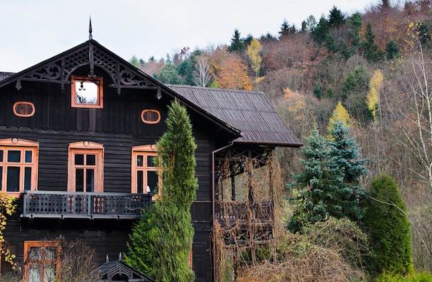Beautiful house or cottage in the hill autumn time.