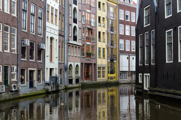Beautiful houses on a canal in amsterdam, netherlands