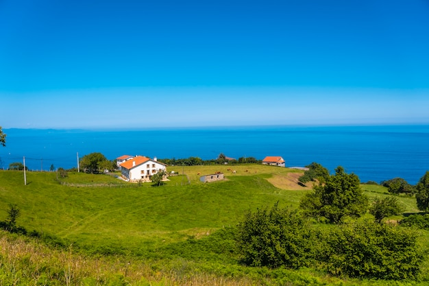 Beautiful houses on the coast of mount igueldo, guipuzcoa, basque country. excursion from san sebastián to the town of orio through mount igeldo walking 3 friends.