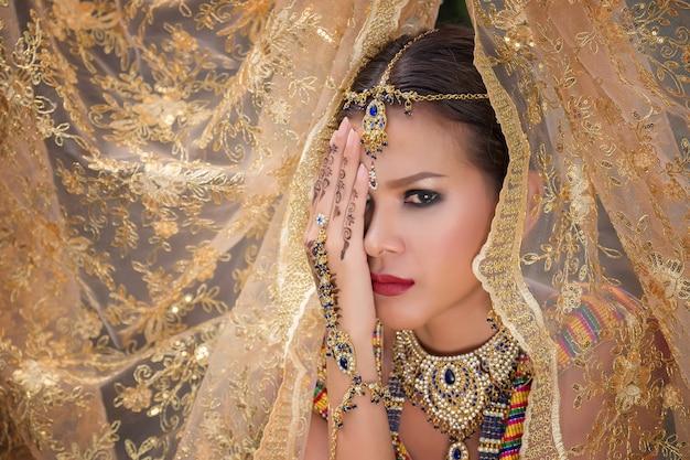 Beautiful indian girl young hindu woman model with kundan jewelry.