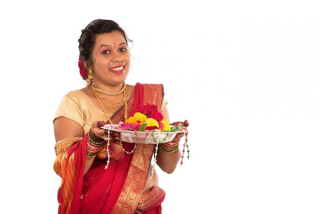 Beautiful indian woman holding flower thali