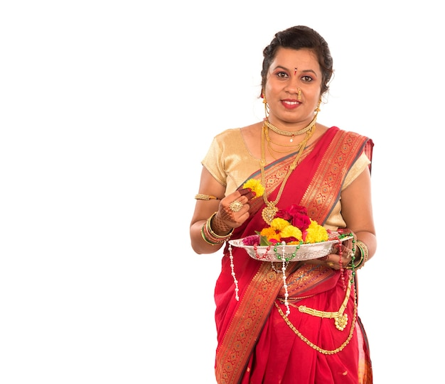 Beautiful indian woman holding flower thali