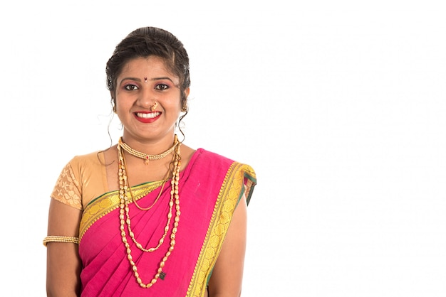 Beautiful indian woman in a saree traditional costume