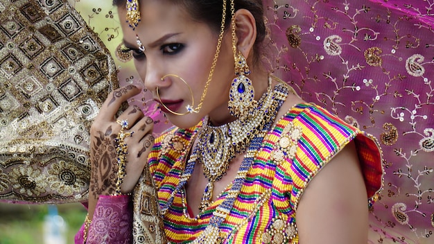 Beautiful indian woman wearing sari female in ethnical indian clothes