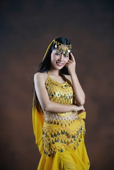Beautiful indian young hindu woman model.traditional indian costume yellow saree .