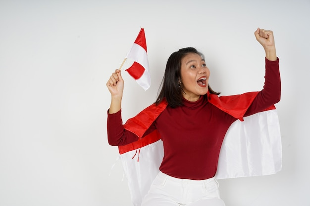 Beautiful indonesian woman happy to celebrate indonesia independence day